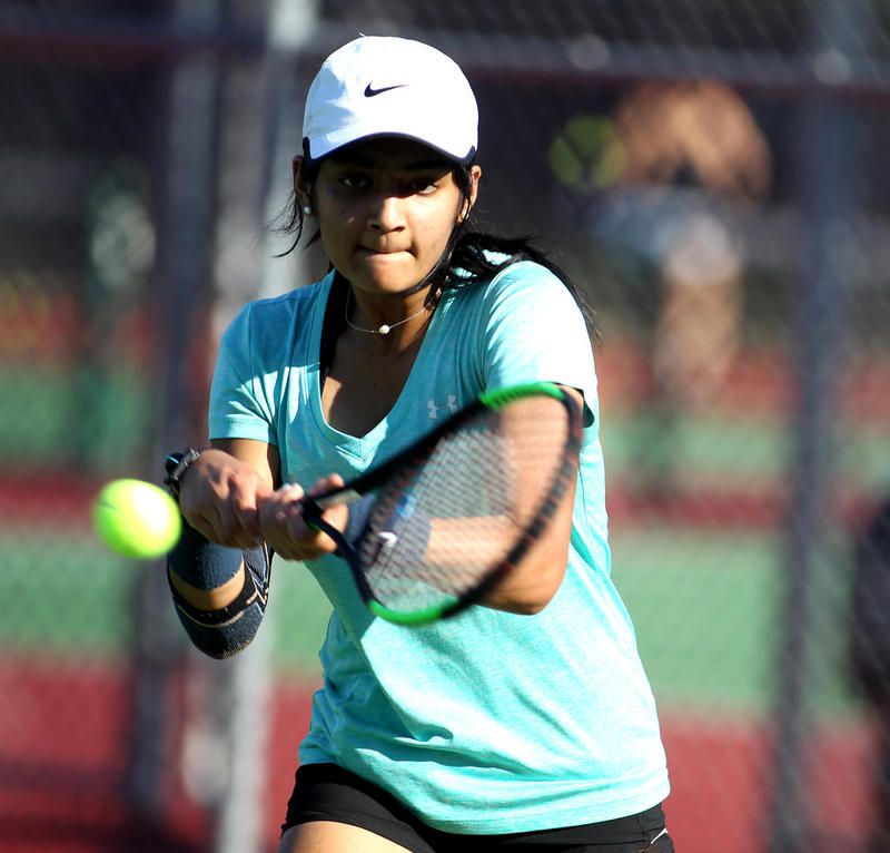 St. Charles East's Smita Dhar returns the ball during a practice with the school's tennis team on Aug. 12.