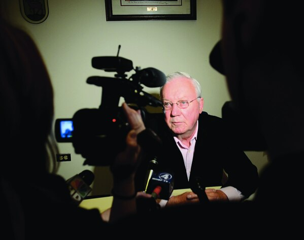 Dixon Mayor Jim Burke speaks with the media after a special City Council meeting  called Monday morning to fire city Comptroller Rita Crundwell, accused of  misappropriating $30 million of the city's money since 2006.