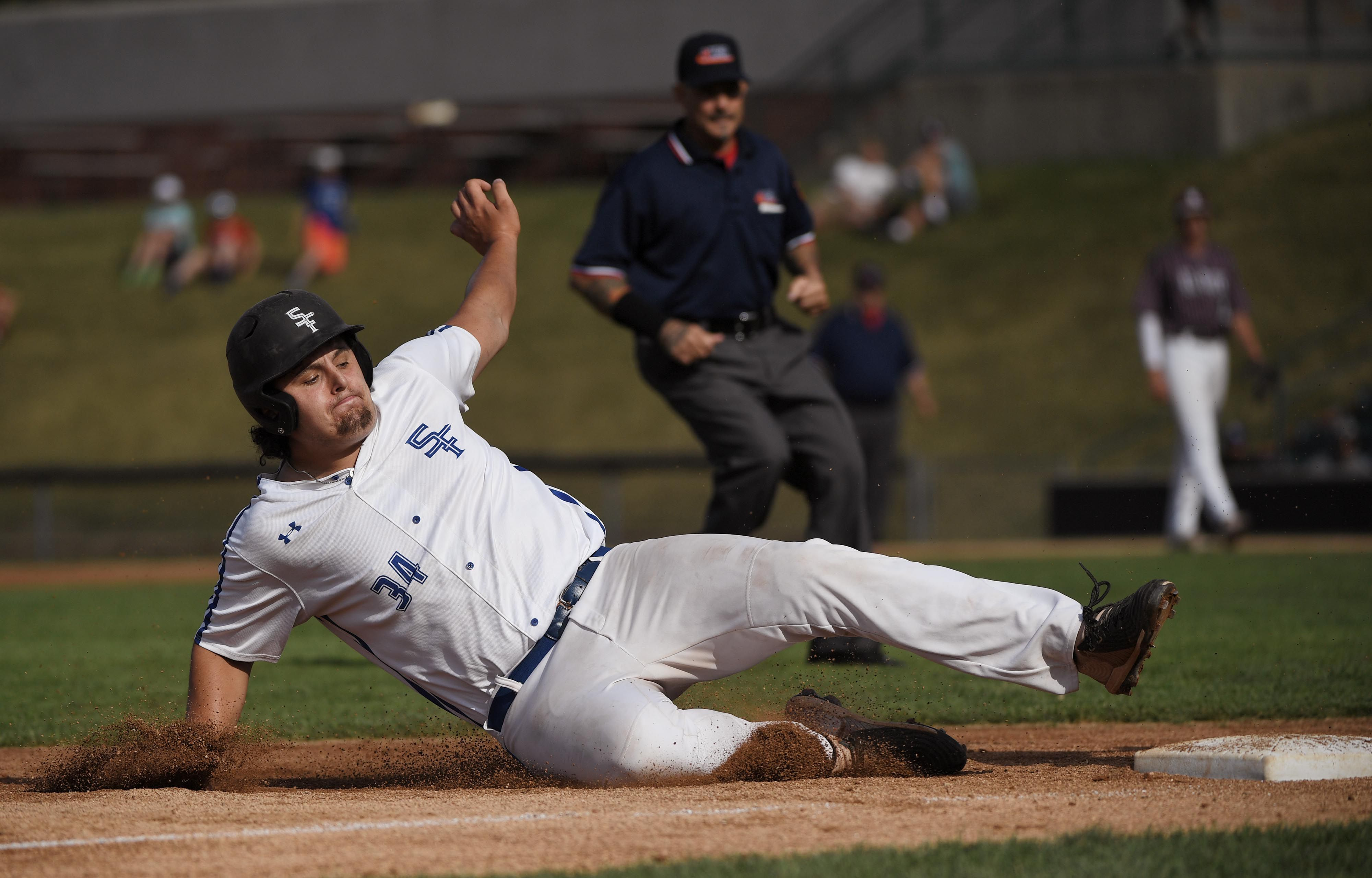 St. Francis' TJ McMillen slides into third base on a passed ball from Prairie Ridge in a Class 3A baseball super sectional at Wintrust Field in Schaumburg Monday, June 14, 2021.