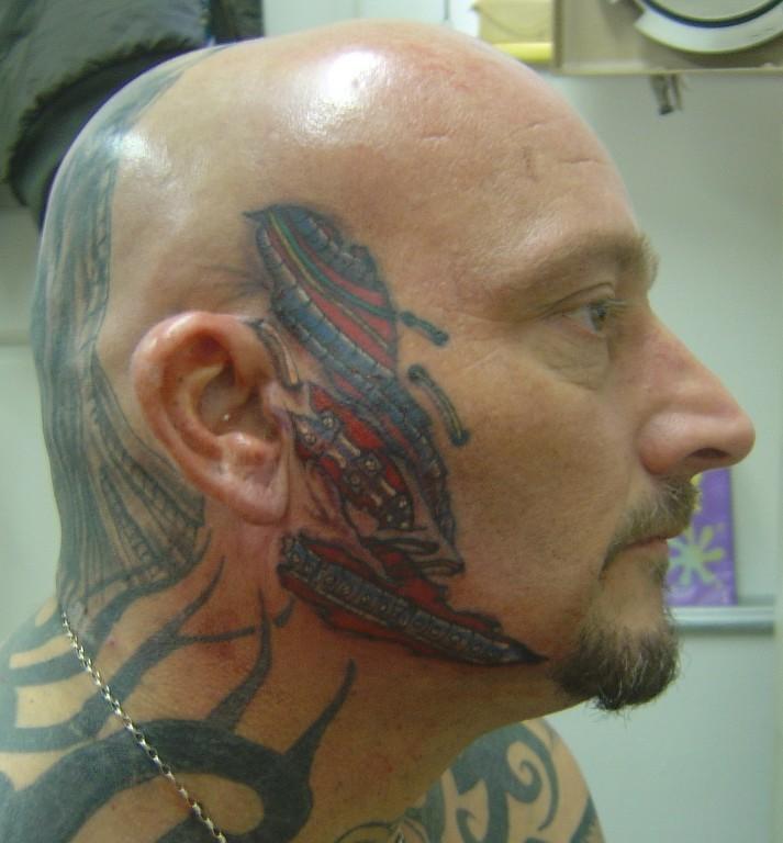 Cool Face Tattoo Design for 2011  SheClickcom