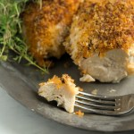 Oven-fried picnic chicken on a fork