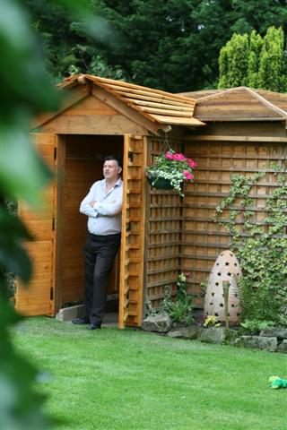 """The winner of shed of the year 2012 – is the pub shed """"Woodhenge"""" owned by John Plumridge"""
