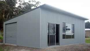 Shed Boss Skillion 9Lx6.5Wx2.7H - With 5 degree pitched roof. Featuring COLORBOND™ Monument roof and trim, with Windspray walls, windows and roller door.