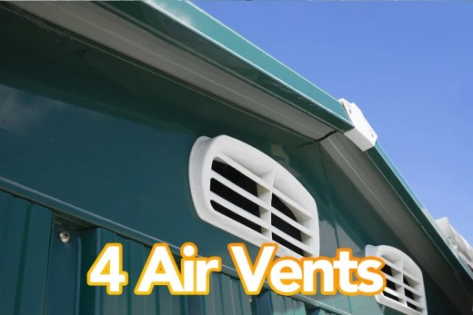 An exterior picture of a class green shed with the focus on the two front air vents. The shed is green, the vents are white and there is a cloudless blue sky above. Text on the image reads '4 Air Vents'