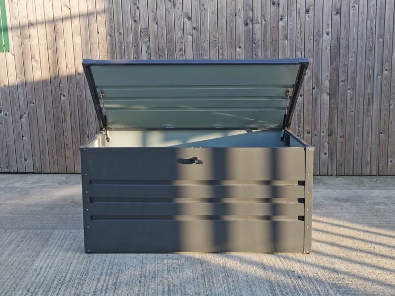 The Garden Storage box from Sheds Direct Ireland with the steel lid open and a partial view of the inside of this large unit.