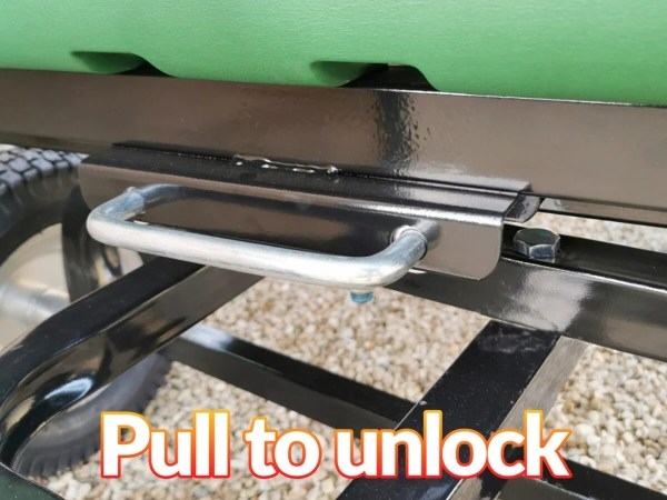 The pull bar on the back of the bucket on the 250L tip cart. It's a shiny silver colour and connected to the black metal bar which grips the bucket itself. It reads 'pull to unlock' on the image.