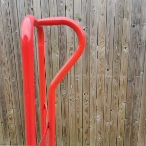 The detail of the handle on the sack truck. It's seen from the side and makes a perfect 'p' shape