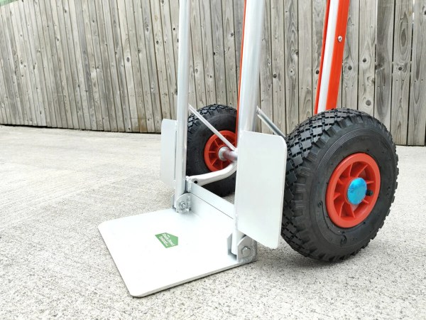 The side view of the hand truck with fold down footplate