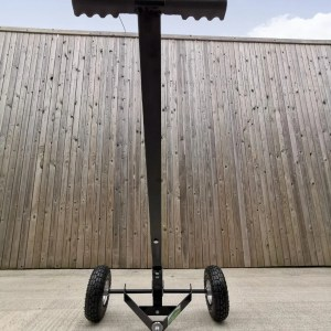 A low view of the trailer dolly, which has the full unit in frame. The sky is in frame above and the unit forms a large 'T' shape, with wheels at the bottom