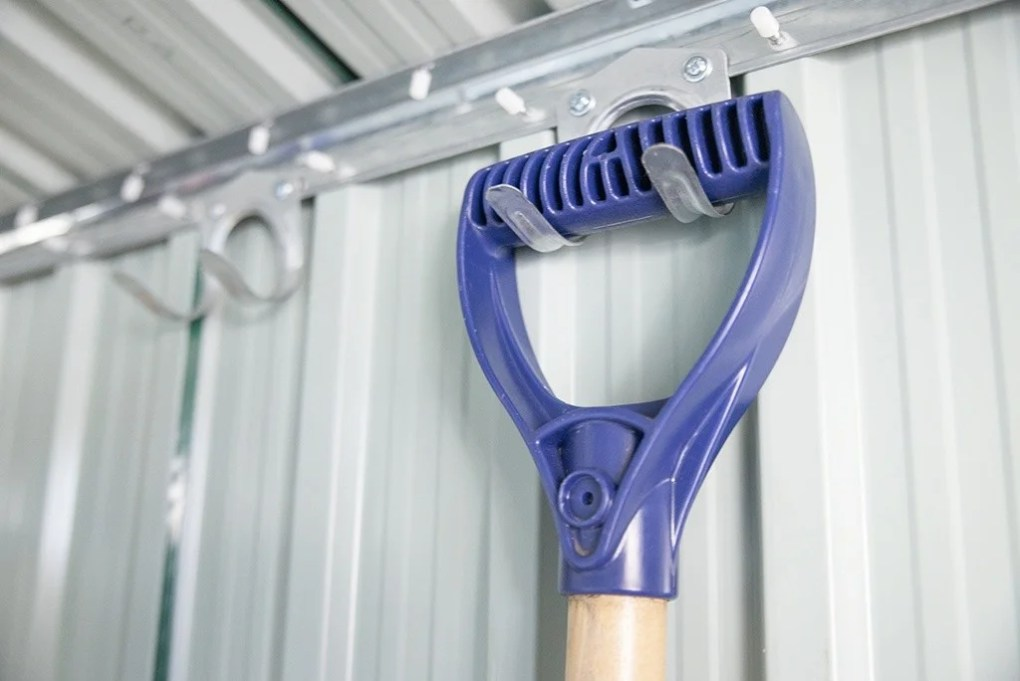 Tool Hook, screwed into a shed, holding up a shovel
