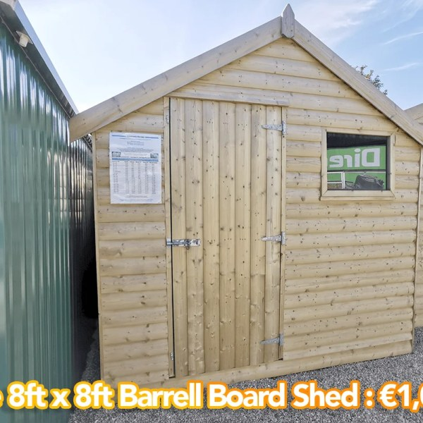 The 8ft x 8ft Barrell Board Shed with the amount €1095 written on it. It has a peaked apex roof to the front. The door is on the left hand side and there is a window on the right hand side.