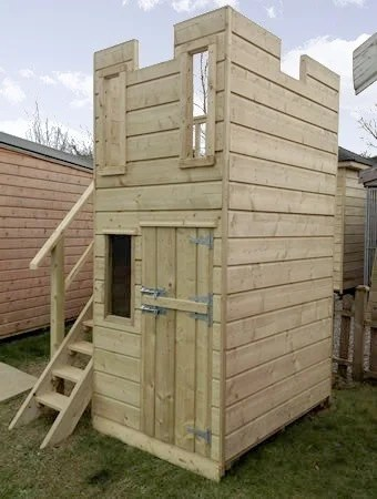 A wooden children's playhouse in a castle style. It is a brightly coloured wooden structure, that looks like a castle. There is a small window and door at a child's height and a ladder. There are two holes at the top of the structure, like you would see in a round tower.