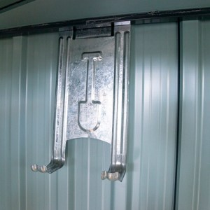 The internal tool hooks. They are thin metal with the imprint of a shovel on them. The wall behind illustrates that this is inside the shed