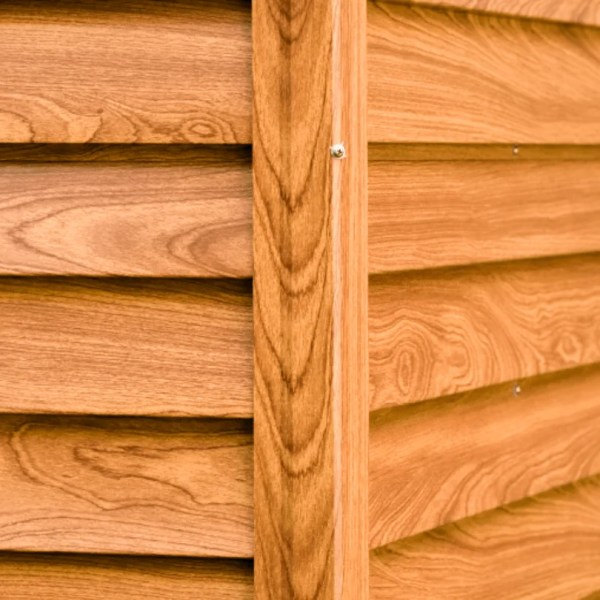 A close up of the panels on a wood grain shed. There's are 6 panels visible which are inset into two sturdier looking panels.