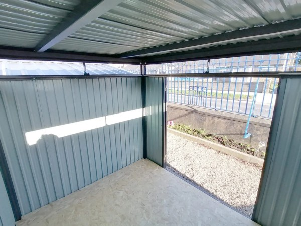 An interior view of the premium panoramic shed as seen from the back, looking towards the doors. The photo is taken up high and looking down