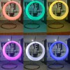 The Led Swing Chair from Sheds Direct Ireland. The triptych )three photos side by side) shows the chair lit up in orange, then green, yellow, bright pink, white and deep-blue in a family home