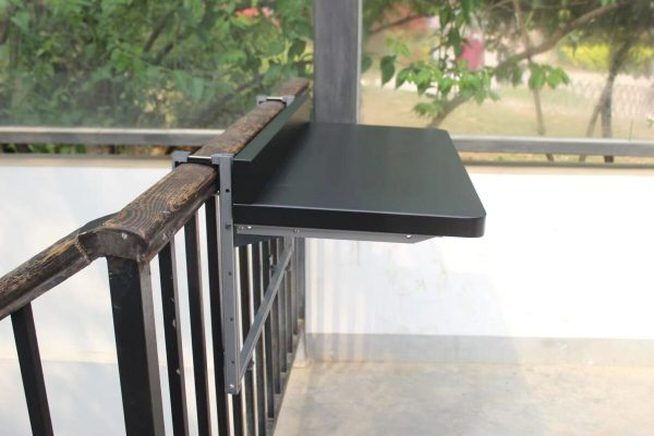 A 90 degree view of the small black railing table