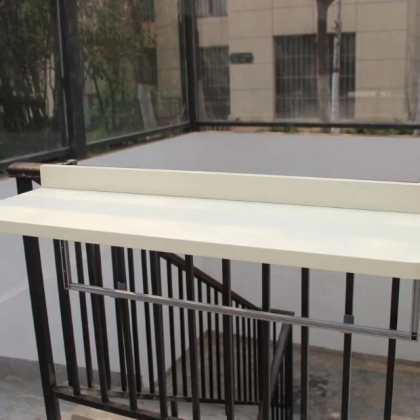 The XL white balcony table on a stairwell railing in the upright position.