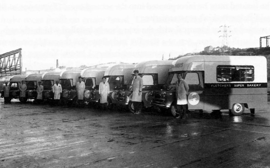 A parade of Fletchers Bakery Vans and Drivers