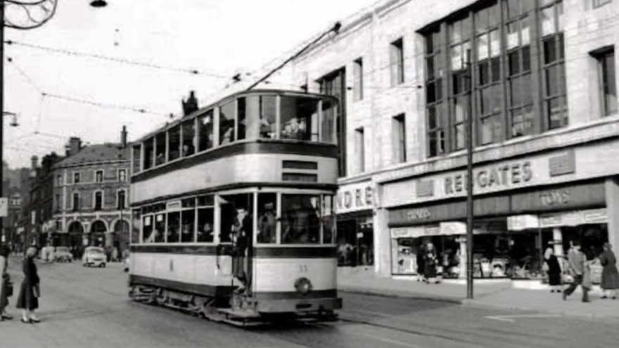 A tram passes by Redgates on The Moor