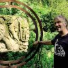 Andrew Vickers with Stoneface sculpture in Storrs Wood
