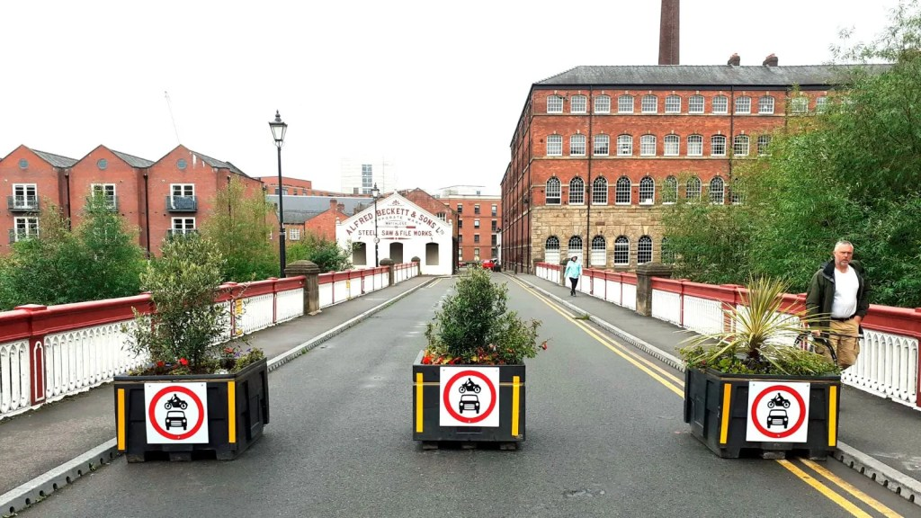 Planters block motor traffic on Ball Street bridge, Kelham Island.