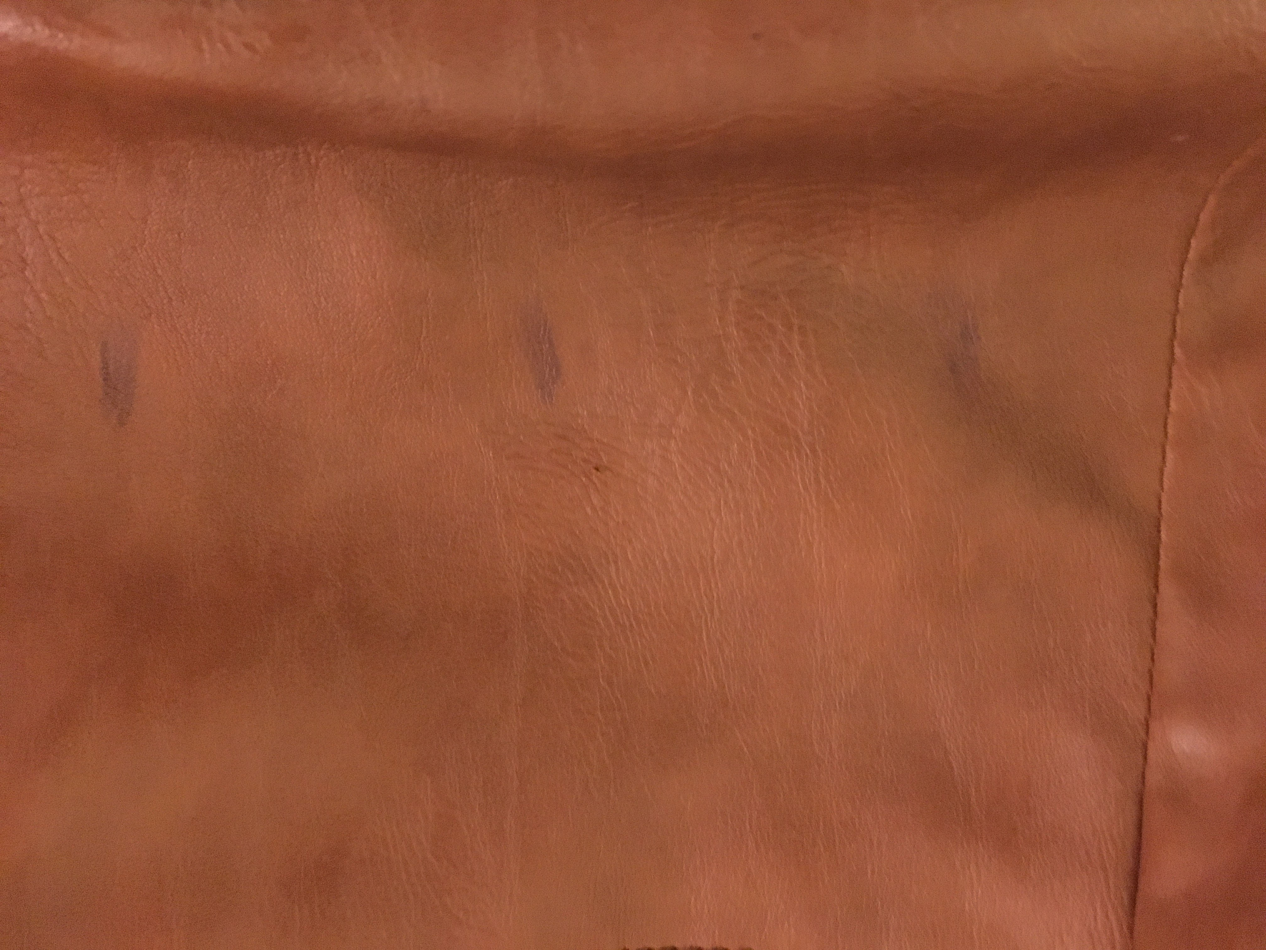 how to get rid of ink marks on leather sofa cover your with a throw an stain out purse