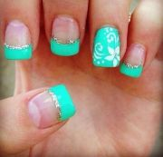 teal color floral nails design