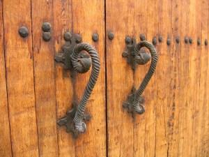 wooden door with fancy handles