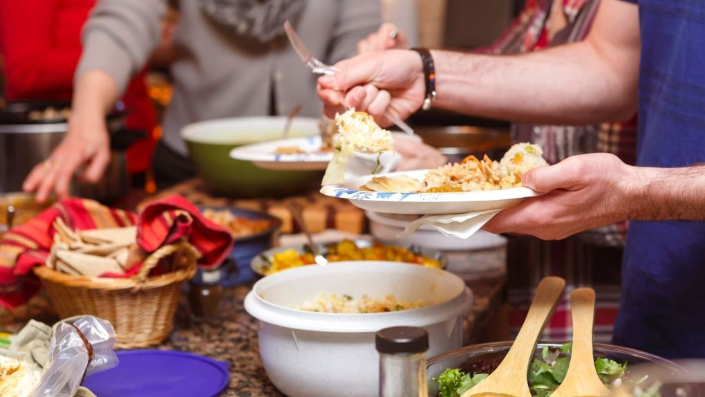 Have a Potluck New year's eve Dinner Party to save money on food.