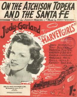 On this 1945 sheet music cover of 'On the Atchison Topeka & Sant Fe' is a head shot of Judy Garland and a drawing of an American-style locomotive hauling an AT&SF passenger train.