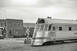 In this black-and-white photograph taken at La Crosse, Wisconsin, the Burlington's streamlined Zephyr diesel express reaches a crossing, showing off its lightweight, stainless-steel construction.