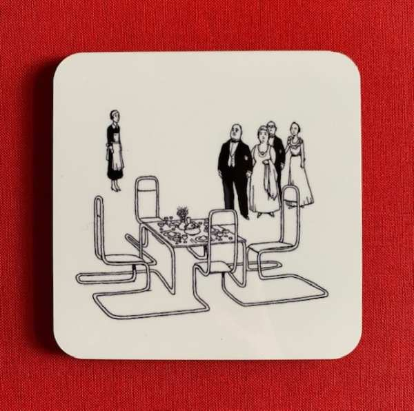 Photograph of a coaster, illustrated with the One-Piece Chromium Steel Dining Suite black and white line drawing by Heath Robinson.
