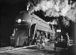 In a black-and-white photograph taken by O. Winston Link in 1957, K2a locomotive No. 127 of the Norfolk & Western Railway makes a stop after crossing the James River in Virginia.
