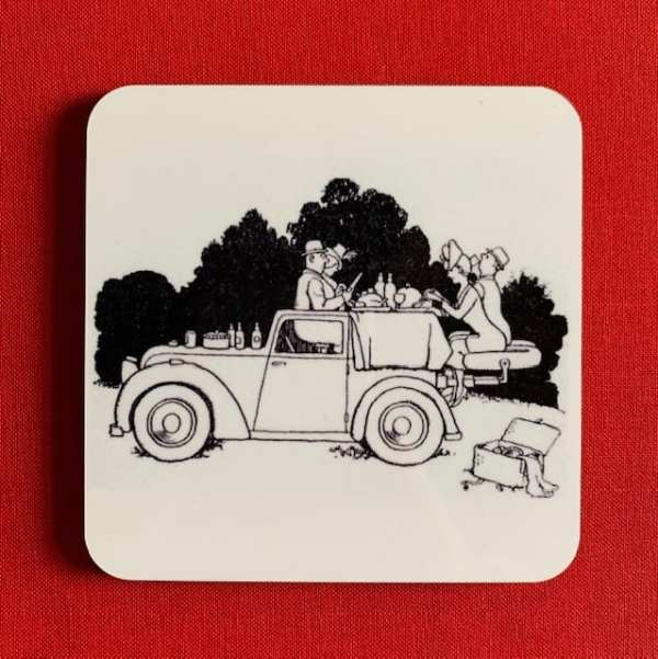 Photograph of a Heath Robinson coaster, illustrated with a black and white line drawing of The Picnic Saloon.