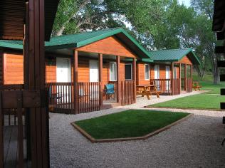 Grass in front of cabins