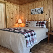 Queen size bed in bunkhouse