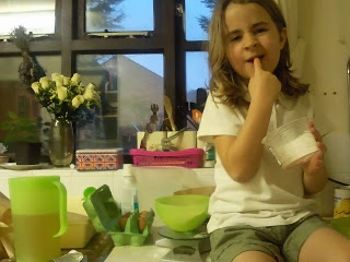 kaycee licking her fingers after making cake