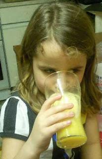 KayCee drinking mango peach fizz