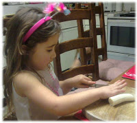 Ella making banana mango shake