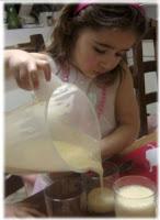 Ella pouring banana mango shake