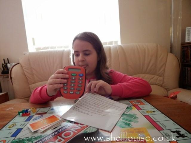 KayCee playing Monopoly