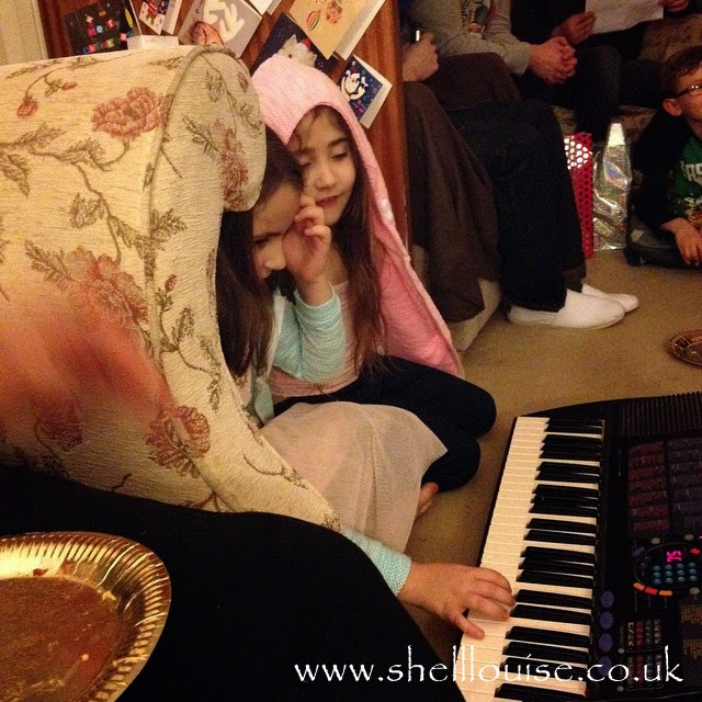Kaycee and Ella giving a piano concert - Christmas Eve photos