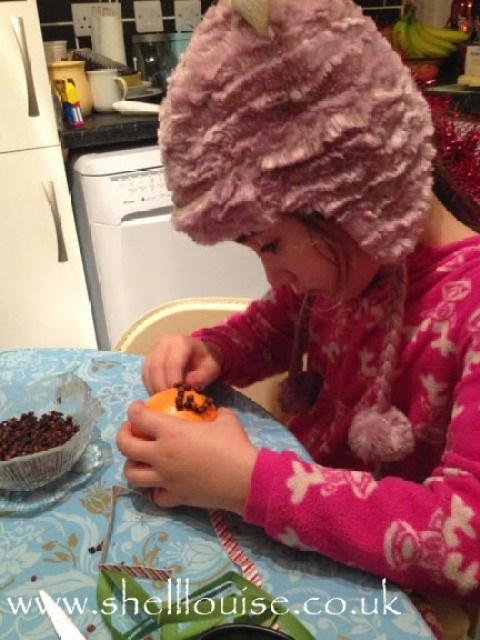 Ella making her Christmas pomander