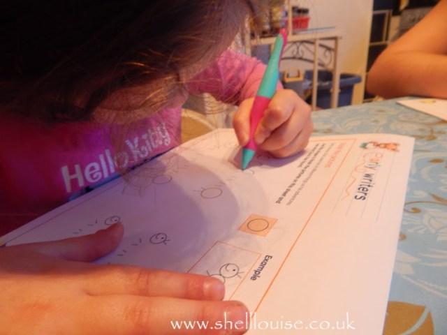 Ella holding a Stabilo EASYgraph pen