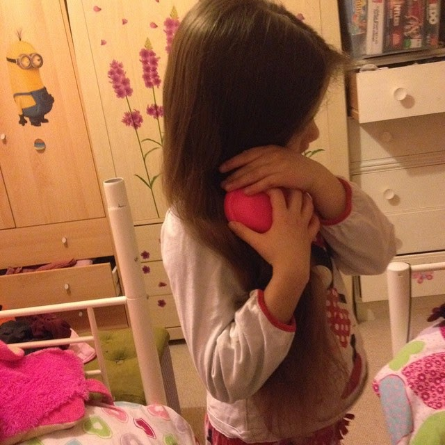 Ella brushing her hair