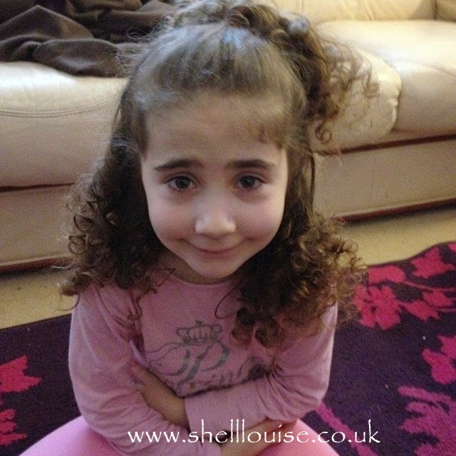 Ella with curly hair