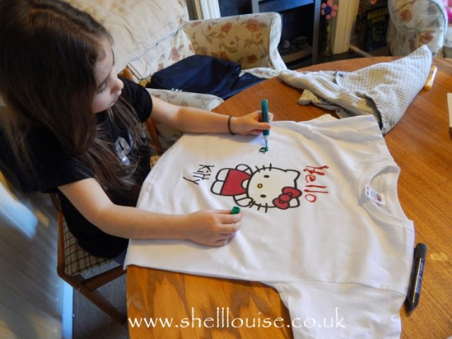 designing t-shirts - Ella using the fabric paints to add more decoration