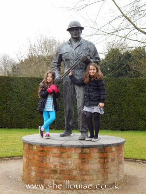 Kaycee and Ella standing in front of a Sculpture at Rufford Abbey