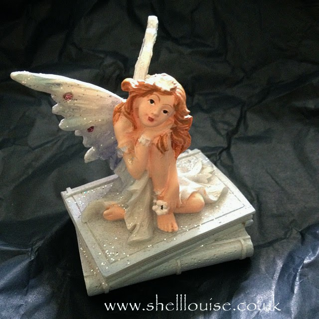 10th wedding anniversary present - a fairy sitting on some books